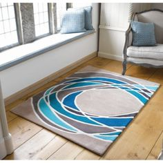 The Carnival Spectre rug features a modern abstract design with a teal and grey circlular pattern on a taupe background which will make a statement to any room. Benefiting from a luxurious, soft Acrylic pile which is easy to clean and colourfast. Modern Prints, Modern Rugs, Teal Image, Teal Rug, Blue Rugs, Neutral Walls, Printed Curtains, Calming Colors, Teal And Grey