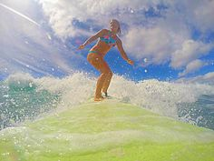 Epic waves - special thanks to Go Pro #gopro for this awesome picture of Amanda riding a beautiful wave in Waikiki #pops #honeygirlwaterwear #shaka www.chicasurfadventures.com/hawaii-surf-camp