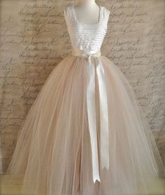 Vintage dress with white bodice, ribbon at waist, and pale pink tulle skirt