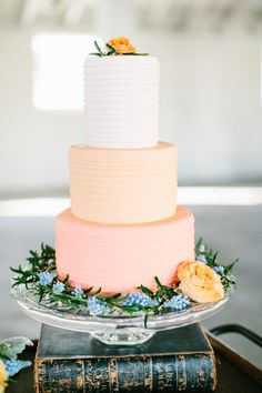 Wedding Cake Inspiration: A three-tier ombre cake with white, pink and peach layers.