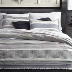 "Upon closer look, contemporary stripes of tonal blues reveal intricate traditional Indian filigree patterns. Jaipur-based designer Manish Tibrewal's geometric design is first hand-carved in a wood printing block, screenprinted onto crisp white percale, then hand-embroidered at the edge by artisans with beautiful precision. <a href=/down-duvet-insert/f10921>Duvet inserts</a> and <a href=""/bed-and-bath/bed-pillows/1"">bed pillows</a> also available.<br /><br /><br /><NEWTAG/><ul><li>Designed…"