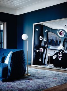 IC Lights F complements the modern vibe in his all blue living room with hardwood floors and navy furnishings. Dark Blue Rooms, Dark Blue Living Room, My Living Room, Cozy Living, Slate Blue Walls, Navy Accent Walls, Navy Walls, Dark Interiors, Colorful Interiors