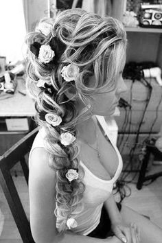 Bridal Hair Loose Side Braid with Flowers throughout the Braid
