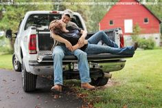 country couple photography red barn boots and a tailgate