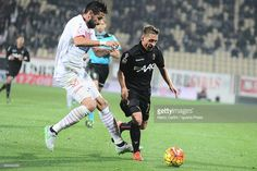 Emanuele Giaccherini # 17 of Bologna FC ( R ) competes the bal with Cristian Zaccardo # 5 of Carpi FC ( L ) during the Serie A match between Carpi FC and Bologna FC at Alberto Braglia Stadium on October 24, 2015 in Modena, Italy.