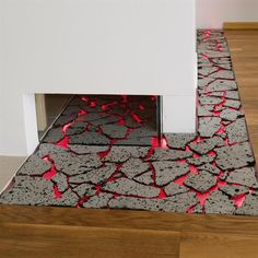 The designer added drama with a lava-tiled channel that flows from under the powder room wall into the living room. Ingjaldsdottir says that the lava pieces are set on a glass sheet that is lit red by LED lighting. She used a different form of lava for the kitchen backsplash. The ground lava is mixed with resin and applied in a 1/2-inch-thick layer.