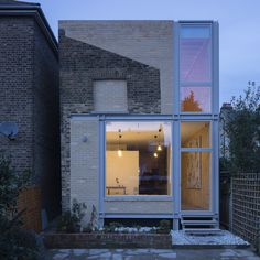 The sloping gable of an old extension to this London residence, remodelled by Tsuruta Architects, has been integrated into its pale brick replacement Terraced House, Brick Extension, Extension Google, Building Extension, Architecture Résidentielle, Architects London, Victorian Terrace House, Architect Magazine, London House