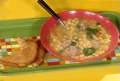 Food Network invites you to try this Mini Meatball Soup recipe from Rachael Ray.