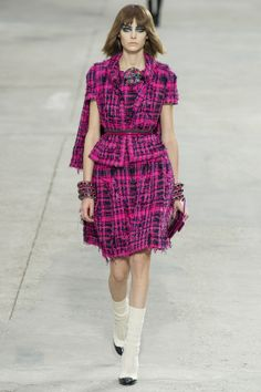 Fuschia pink and a host of colorful brush strokes punctuated Chanel's Spring/Summer 2014 collection.