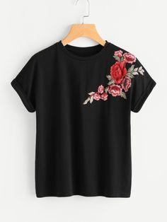 T-shirt con toppa di fiore
