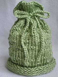Loom Knit - Top Knot baby hat.  Made on 44 peg DA hat loom.  From Ravelry by Faith Schmidt