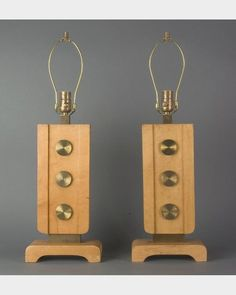 Blond wood bombshells: 1960 table lamps with brass disc detail.