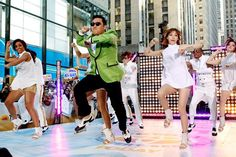"Gangnam' edges out Justin Bieber's video for his song 'Baby'.    South Korean rap star Psy's music video ""Gangnam Style"" on Saturday became the most-watched item on YouTube with over 800 million views, edging past teen star Justin Bieber's 2-year-old video for his song ""Baby.""    The milestone was the latest pop culture victory for Psy, 34, a portly rap singer known for his slicked-back hair and dance style who has become one of the most unlikely stars of 2012."