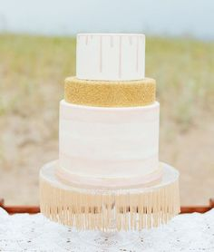We've seen fringe in a lot of unique places, but we hadn't quite believed that it had a place on the dessert table. This incredible, Gatsby-inspired cake platter proves that we were so completely wrong. | See more fun fringe decor details here: http://www.mywedding.com/articles/fringe-wedding-details-to-sweep-you-off-your-feet/
