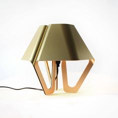 'Hexa' the aluminum table lamp, is completely made in a local workshop in Holland.  At first the aluminum is cut from a sheet of metal, after that the aluminum gets folded by hand to it's final shape.  'Hexa' get it's color from a special process where the lamp is immersed in several different baths with different pigments.