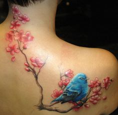 A gorgeously detailed blue bird and spring blossom tattoo. #blue #bird #tattoo #ink