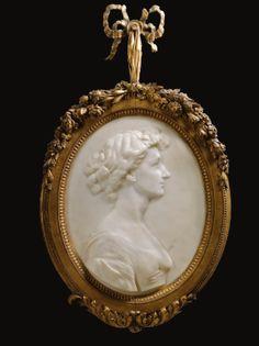 FRANCIS DERWENT WOOD  BRITISH  1871 - 1926  RELIEF PORTRAIT OF MRS GEORGE CRAWLEY