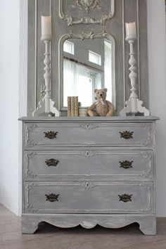 Antique dresser & the architectural design on wall above...