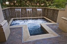 """No space to too small for a """"plung"""" pool or spa.... this one is more of a water feature with the shear decents and tile wall"""