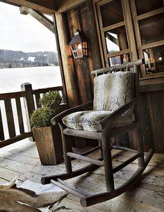 rustic old wood outside chair love it minus the skin on the floor nice rug instead
