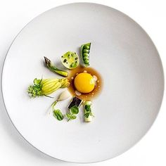 Spring vegetables with poached pheasant yolk & mushroom bouillon. ✅ By - @ronnyemborg /  By @signebirck ✅  #ChefsOfInstagram