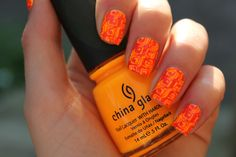 Neon orange geometric nails will get attention they deserve! #nailart #nailpolish #orangenails #geometricnails #neonnails