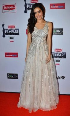 Shraddha Kapoor appeared in a sequinned white Shehlaa gown by Shehla Khan. The actress looked really pretty with the minimal makeup and that gorgeous smile. - bollywoodshaadis.com