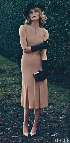Whoa, this is one heck of a dress. Vogue January 2012, Amber Valletta: Calvin Klein Collection silk-crepe dress. LaCrasia gloves. Ralph Lauren Collection clutch.