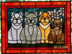I'd love to have these stained glass cats hanging in my Florida room.....