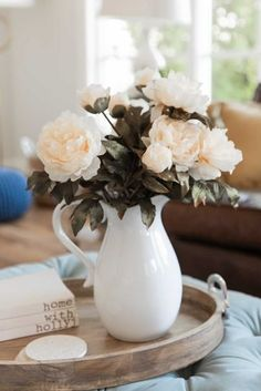 Add a pop of peach to your fall home decor this season with these fake peony flowers that look real! Style in your favorite vase for a simple, fresh look! Shop artificial fall peony stems at Afloral.com. Image by @homewithhollyj.