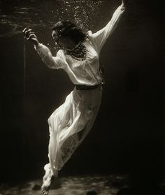 Fashion model underwater in dolphin tank, Marineland, Florida, 1939 by Toni Frissell