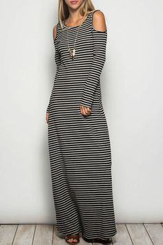 38153e63b A form fitting black and grey knit dress. This dress has cold shoulders and  long. Shoptiques