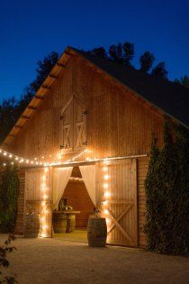 Barn door dressing with simple drapes & pretty lights make for a pretty wedding entrance.