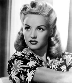 Victory rolls....if I could fix my hair like THIS I would wear it this way EVERYDAY.