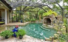 Tropical Swimming Pool with Indoor pool, exterior stone floors, French doors, Skylight, and hot tub cave