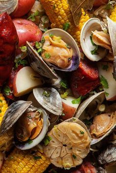 Try a no-toil clam boil - New England Portuguese style. Complete with clams, linguiça sausage, potatoes, corn, and garlic.
