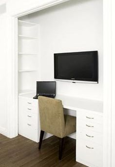 Closet Office With Storage Shelves Built On The Sides And Filing Cabinets  Under Desktop.