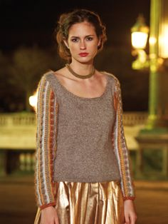 Knit this womens sweater with crocheted stripe sleeves from Parisian Nights. A design by Marie Wallin using the beautiful Kidsilk Haze, a versatile fine yarn made from 70% mohair and 30% silk. This knitting pattern is suitable for intermediate knitters