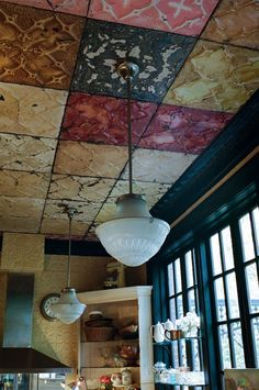 Love these textured and painted ceiling and wall tiles.