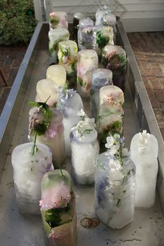 A country wedding - icing down the bar with flowers frozen into water jugs and juice bottles.