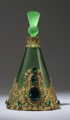 Bottle enhanced with painted paper doily? Add gems. Hmmmm....ideas are running rampant.