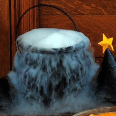 caulldron with dry ice and a splash of water. Really easy!