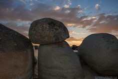 """""""Sunset at Whale Beach, Tahoe 4"""" - Photograph of a sunset at Whale Beach on the East Shore of Lake Tahoe, shot through a pile of boulders. W..."""