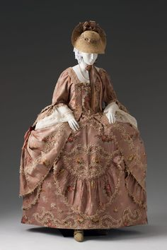 "Robe à la Française dressed à la Polonaise circa 1760-1780. Silk brocade with a field of flowers and lived trimmed with ""fly"" fringe."