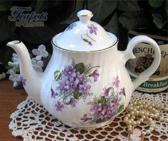 The Heirloom Violets Bone China Teapot features bunches of purple violets and gold edging. Tea Cup Saucer, Tea Cups, English Teapots, China Teapot, Sweet Violets, Cuppa Tea, Teapots And Cups, Tea Art, My Cup Of Tea