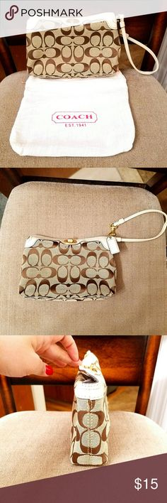 Coach Medium Turn Lock Wristlet Preloved Coach wristlet.Coach logo in tan & White w/ a unique turnlock closure.1 Slip Pocket & key ring inside.This size wristlet is perfect for a phone & small items,it's bigger than a usual wristlet but smaller than a purse. Purple lining has some makeup stains(pic 6,7) metal turn lock has some wear(pic 5),the only stain on the outside is shown in pic 8 (tiny brown dot). This wristlet is still in great condition except for the inside that no one can see…