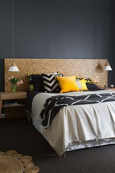Love the bed head, wall colour, carpet and rug combo!