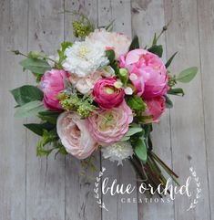 This wedding bouquet features tons of gorgeous, silk flowers. The shades of blush, cream, pink and green mix together to create a stunning bridal bouquet with just enough color. The stems are shown wrapped in twine, to give it freshly picked, garden bouquet vibe. This silk flower bouquet is about 12-14 in diameter and about 12-14 in height. Flower selection and color, as well as stem wrap selection and color, can be customized upon request. We offer cream lace, natural burlap, burlap & la...
