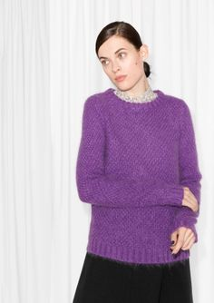 Made from mohair blend, this sweater has an effortless elegance in its round silhouette and oversized style.