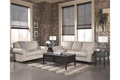 The Deasil - Iceberg Sofa from Ashley Furniture HomeStore (AFHS.com). Leather Match upholstery features top-grain leather in the seating areas with skillfully matched vinyl everywhere else.